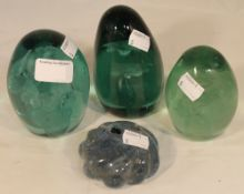 Three Victorian glass dump weights and a Victorian paperweight