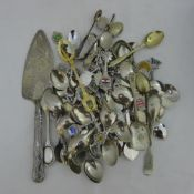 A quantity of souvenir spoons and other silver plate