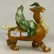 A Chinese terracotta figure of a dragon