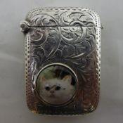 A silver vesta depicting a cat