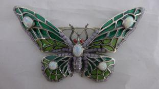 A silver plique-a-jour butterfly brooch