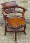 A Victorian mahogany swivel desk chair