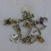 A silver charm bracelet and charms