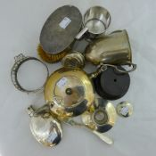 A silver trophy cup and other loose silver,