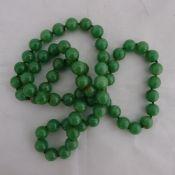 A jade bead necklace