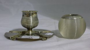 A silver mounted match striker, together with a silver match striker/ashtray,