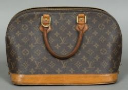 A vintage Louis Vuitton handbag Stamped Louis Vuitton, Paris, Made in France and numbered TH1919.