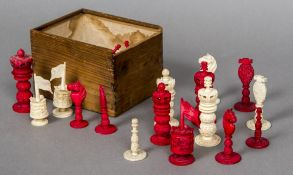 An early 19th century Chinese Export carved ivory and stained ivory chess set The white Rooks with