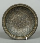 An 18th/19th century Cairo ware dish The interior with scrolling white metal onlays,