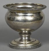 A 19th century American silver pedestal vase The bulbous body inscribed Presented to James