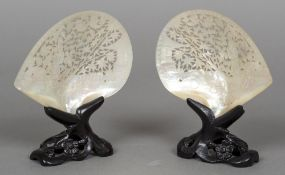 A pair of late 19th century Canton carved shells Each of pierced form,