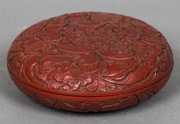 A Chinese red cinnabar lacquered box and cover Profusely worked with floral sprays. 17 cm diameter.