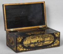 A 19th century chinoiserie lacquered writing slope Of hinged rectangular form,