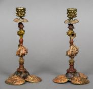 A pair of cold painted bronze candlesticks Each formed as various sea shells. Each 23.5 cm high.