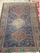 A Caucasian wool rug The midnight blue field enclosing a pole medallion,