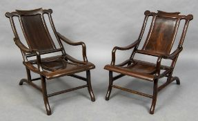 A pair of late 19th century Chinese hardwood moon gazing chairs Each shaped top rail above a