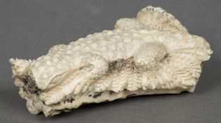 A late 19th/early 20th century antler carving of a lizard Naturalistically modelled on fern fronds.