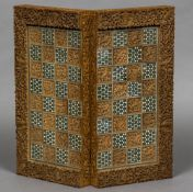 A late 19th/early 20th century Sadeli ware games board One side for chess,