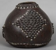 A Congolese drum Formed from a gourd with applied cowrie shell and seed pod decoration. 41 cm high.
