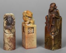 Three Chinese carved soapstone seals Two figurally carved, the other carved with a dog-of-fo.