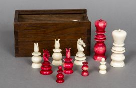 An early 19th century Anglo-Indian mono-block turned ivory and stained ivory chess set The Kings