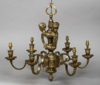 A gilt bronze six branch hanging light by Bela Pasztor The scrolling branches below three putto