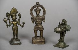 Three Indian bronze figures Each of varying form. The largest 15.5 cm high.