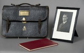 A George VI leather satchel by John Peck & Son With gilt royal cypher, the lock stamped Bramah,