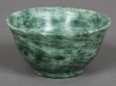 A Chinese hardstone, possibly jade, bowl Of flared form, with a stepped foot. 10 cm diameter.