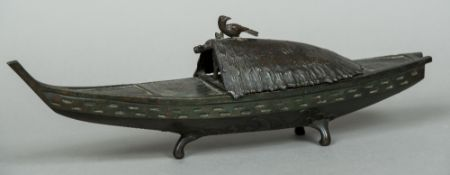 A Japanese Meiji period bronze koro Formed as a boat with a removable thatched roof mounted with a