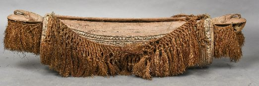 A large Papua New Guinea tribal split drum Of carved oval spherical form,