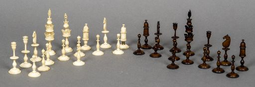 A 19th century white and brown stained bone chess set The King's each 10.5 cm high.