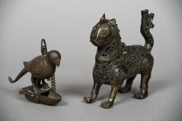 A 19th century Indian bronze hanging oil lamp Formed as a bird;