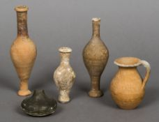 A small collection of Romano Cypriot pottery and glass antiquities Including three pottery vases,