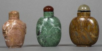Three Chinese carved hardstone snuff bottles and stoppers Of typical form. The larger 7.5 cm high.