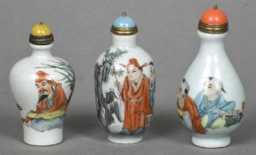 Three Chinese porcelain snuff bottles Of baluster form,