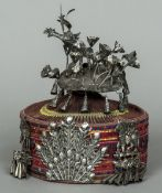 A Tibetan hat Of domed circular form, mounted with unmarked white metal adornments. 25 cm high.
