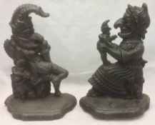 A pair of cast iron door stops modelled as Punch and Judy 32 cm high.