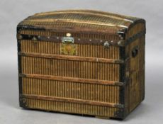 A late 19th/early 20th century French steamer trunk With stripped pattern canvas covering (in the