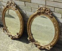 A pair of Victorian gilt framed girandole Each of oval form with pierced crestings and twin candle