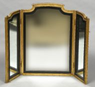 A 19th century carved giltwood framed triptych dressing table mirror Of twin hinged section form,