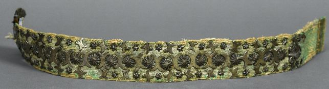 A 19th century Eastern unmarked white metal mounted belt With star and X-section applique.