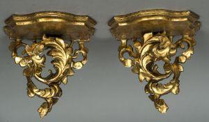 A pair of giltwood wall brackets Each with shaped shelf supported on an acanthus scroll.