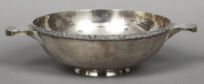 A large silver twin handled quaich, hallmarked London 1988,