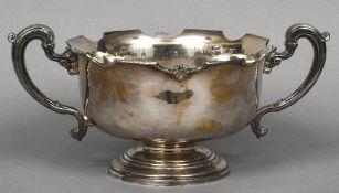 A silver twin handled rose bowl, hallmarked Birmingham 1930,
