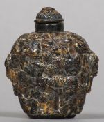A Chinese tortoiseshell snuff bottle Decorated in the round with storks amongst tree filled