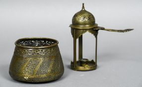 A 19th century Islamic brass chamberstick Of hinged domed lidded form;