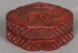 A late 19th/early 20th century Chinese cinnabar lacquered box and cover Of serpentine form,