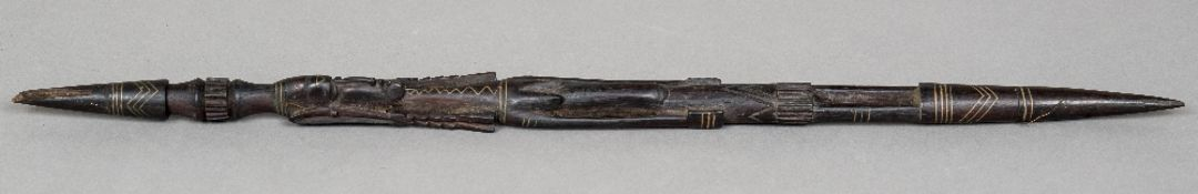 An African tribal Zulu chief's baton The hardwood carved figural staff with copper banded inlaid