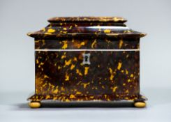 An early 19th century tortoiseshell tea caddy Of serpentine form,